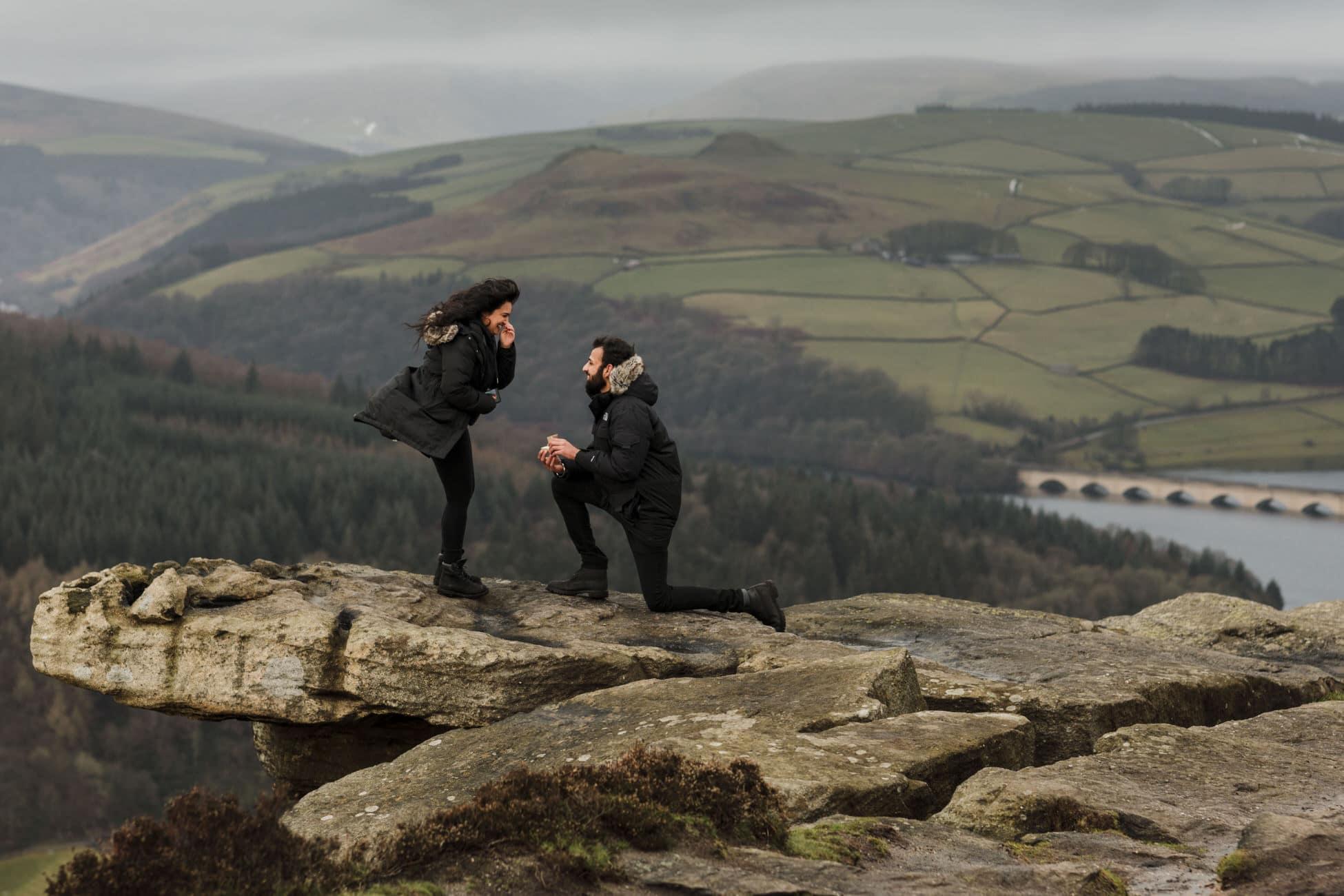 Surprise engagement proposal photo Bamford Edge in the Peak District