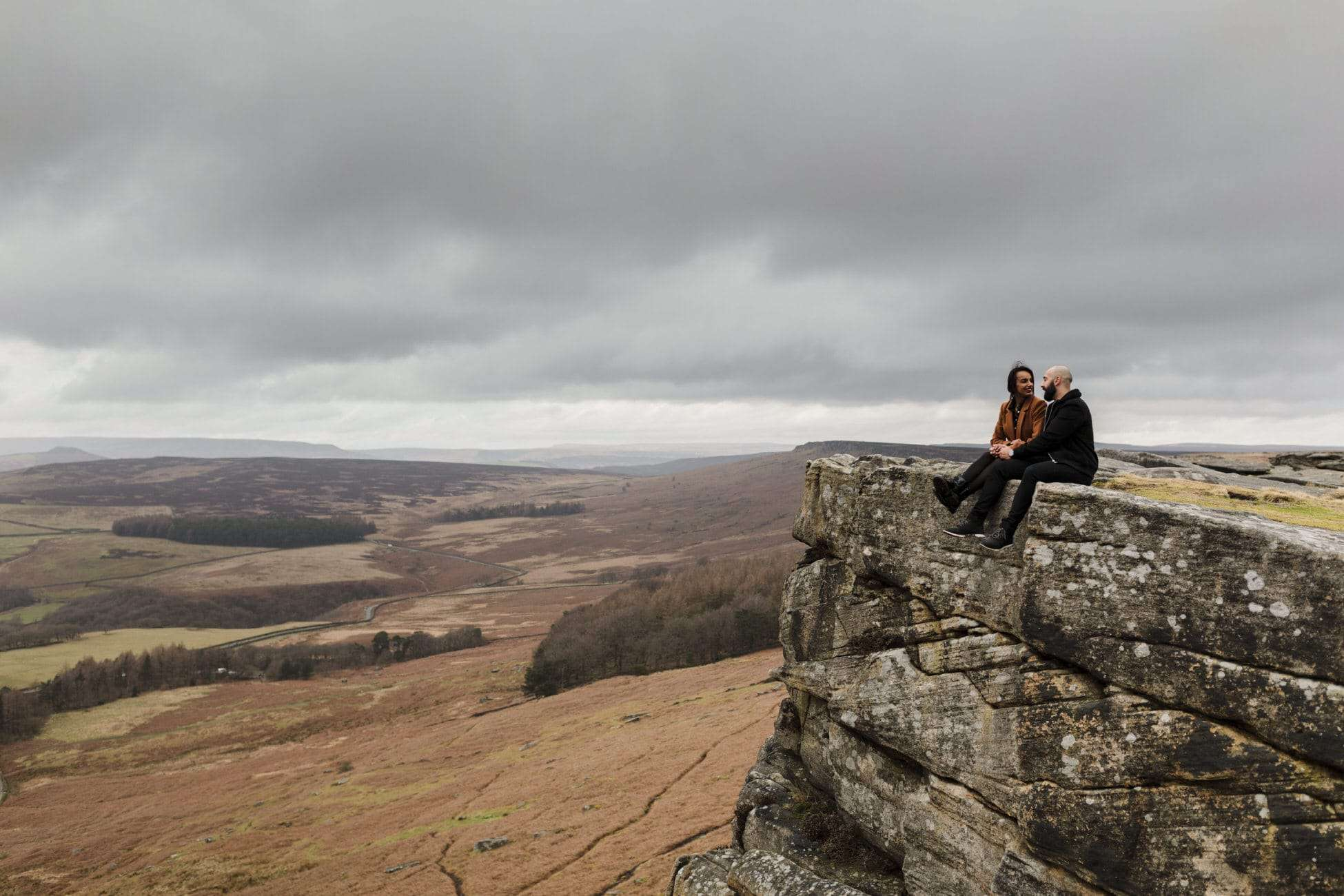 Surprise engagement proposal photo on Stanage Edge in the Peak District